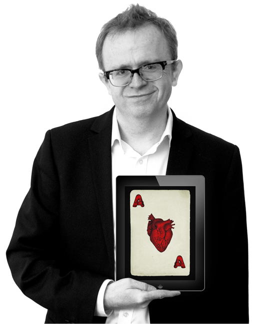 iPad magician NOEL QUALTER holds holds an iPad showing an anatomically correct Ace of Hearts over his real heart